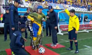 Paraplegic Juliano Pinto kicked off this year's World Cup using a brain-controlled robotic exoskeleton. (Source: The Guardian)